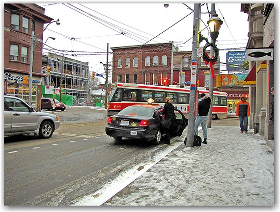 taxi, cabbagetown, streetcard, carlton street, parliament street, intersection, snow, ice, winter, road, toronto, city, life
