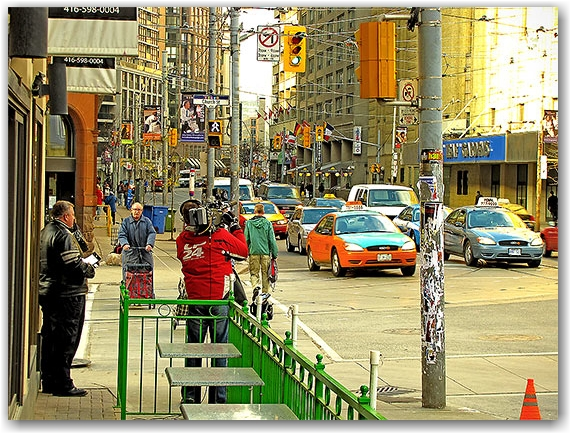 cameraman, cp24, news, reporter, cam woolley, church street, carlton street, maple leaf gardens, taxis, traffic lights, toronto, city, life