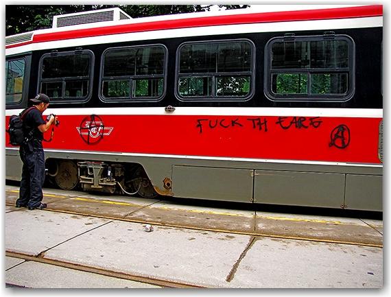 g20, protests, riots, streetcar, vandalism, graffiti, queen street west, toronto, city, life