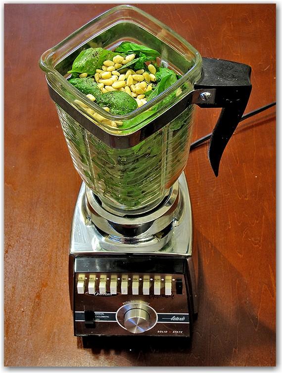 the traditional italian way of making basil pesto